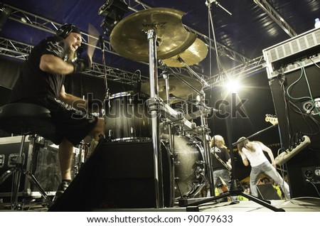 "RADZIONKÓW - 2011 AUGUST 27:  Tomasz ""krzyyk"" Krzaniak - Drumer of ""Turbo""  - heavy metal group during performance called "" Dobry rock europo"" im Radzionków. Poland - stock photo"