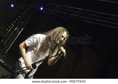 """RADZIONKÓW - 2011 AUGUST 27:Tomek Struszczyk -vocalist of """"Turbo""""  - heavy metal group during performance called """" Dobry rock europo"""" im Radzionków. Poland - stock photo"""