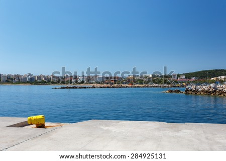 Rafina port with white houses against a blue sky and blue waters in, Greece - stock photo