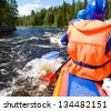 Rafters in a rafting boat on Pistojoki river in Karelia, Russia - stock photo
