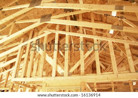 Rafters of a new home under construction - stock photo