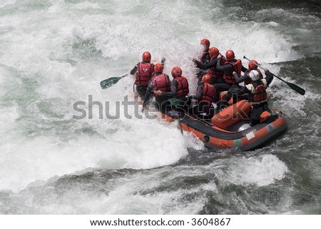 Rafting boat on a whitewater river - stock photo