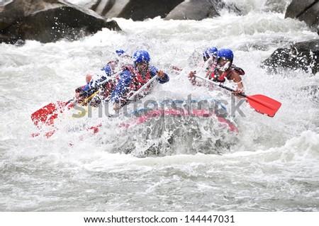 Rafting, extreme, team, sport, fun, active, relax,splashing the white water. - stock photo