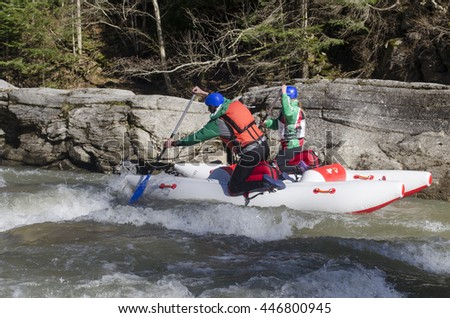 Rafting in Carpathian mountains on catamarans with inflatable frame - stock photo
