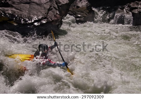 Rafting on dangerous mountain river - stock photo