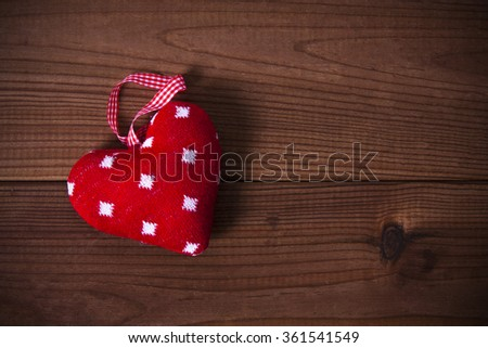 rag heart on old wood