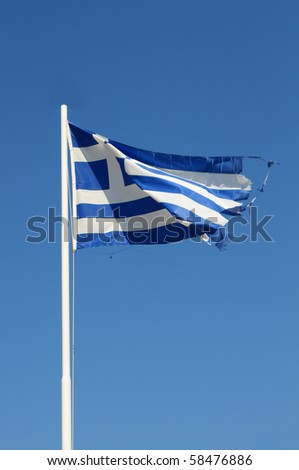 Ragged flag of Greece waving in wind vertical - stock photo