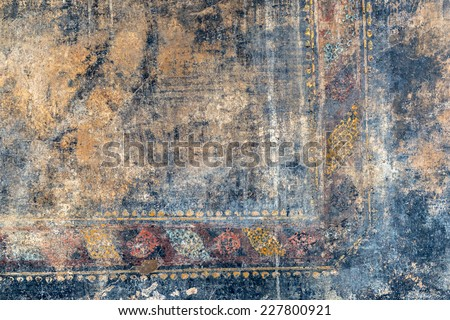 Ragged fresco on the wall in Pompeii, Italy. Background. - stock photo