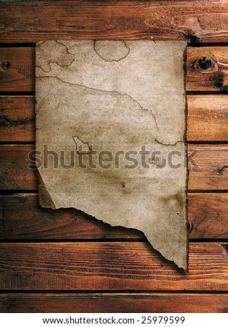 Ragged Old Paper On Brown Wood Wall