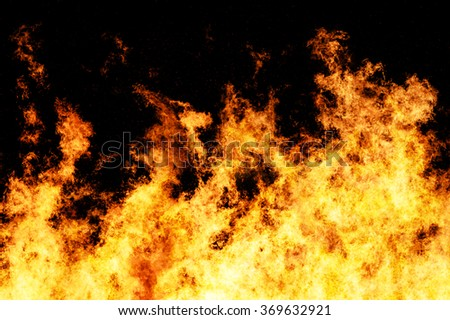 Raging fire shot at a high shutter speed to freeze the motion of the flames - stock photo