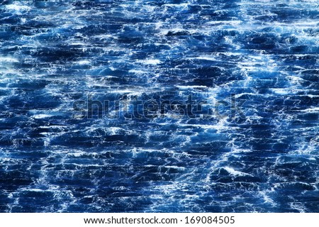Raging sea with furious waves and fierce wind - stock photo