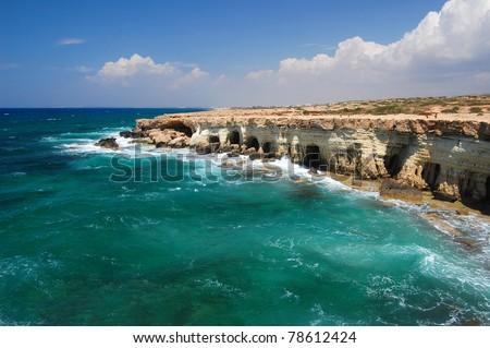 Raging sea with rock  cliffs on Cyprus island near Ayia Napa - stock photo