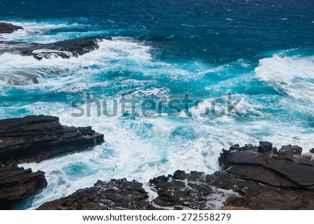 raging waves of rocky beach - stock photo
