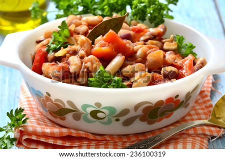 Ragout from beans with bell pepper and onion in tomato sauce. - stock photo