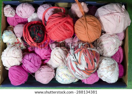 Rags of different color for use in a loom when weaving carpets, photo from the North of Sweden. - stock photo