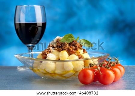 ragu gnocchi and wine - stock photo
