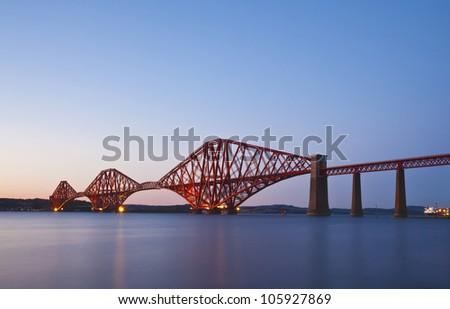 Rail Bridge over The Firth of Forth, crossing between Fife and Edinburgh at dusk, Scotland. Night scene - stock photo