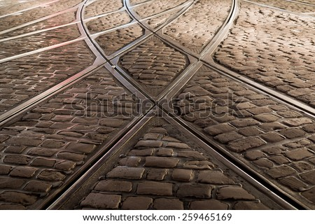 rail crossing of tramway in Freiburg at night  - stock photo