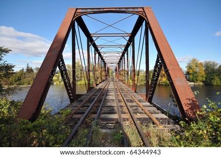 Rail length across the river  on steel bridge - stock photo