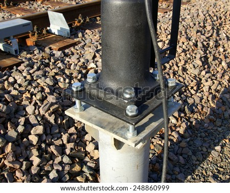 Rail pole mount in sunny day - stock photo