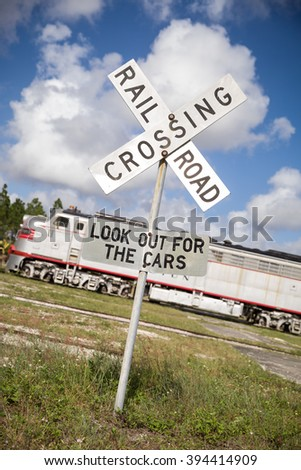 Rail road crossing sign on the train station outdoors. - stock photo