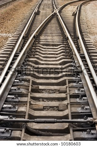 rail road goes to different ways  (focus further to the top end) - stock photo