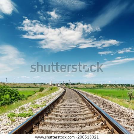 rail road to horizon under deep blue sky - stock photo