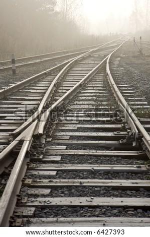 Rail road. Vanishing point. Sepia tone photo. - stock photo