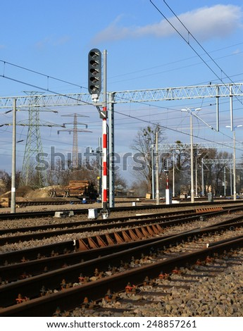 Rail tracks and  semaphores in sunny day - stock photo