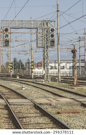 Rail - tracks, switches and signal masts on an Italian train station - stock photo