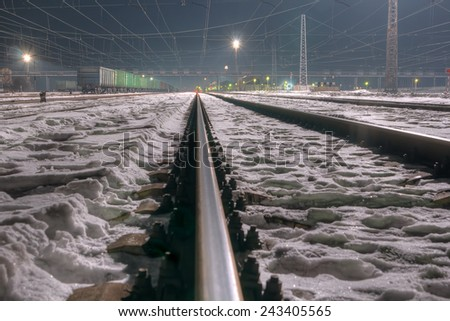 Rail way station at night in winter. - stock photo