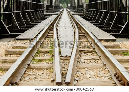 Rail with wood and stone