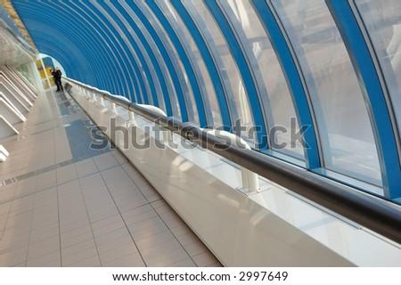 Railing along windows in modern bridge - stock photo