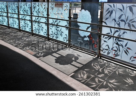Railing and decorated glass as fence and reflections in the Station - stock photo