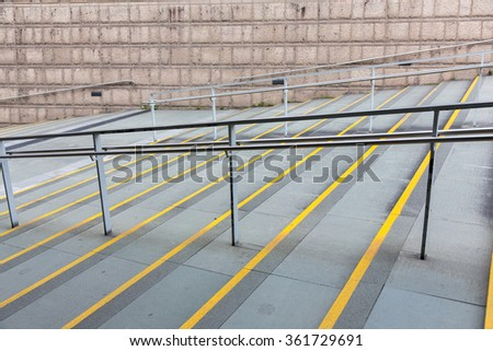 Railing and stairs to the subway in hong kong - stock photo