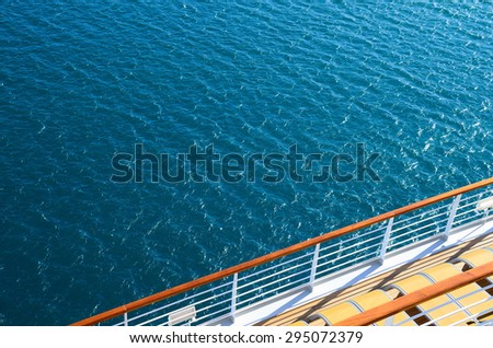 railing on a cruise ship in the blue sea
