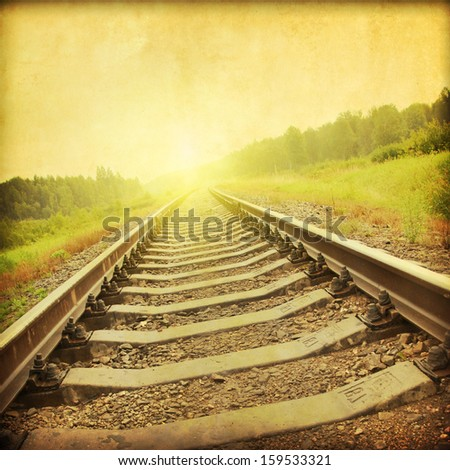 Railroad at sunset in grunge and retro style.  - stock photo