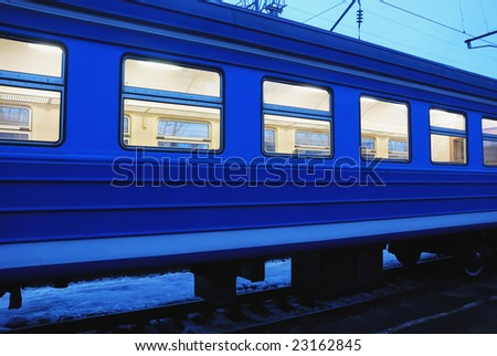 railroad blue carriage by night in winter