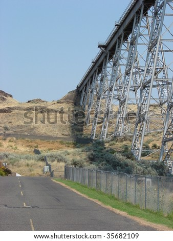 Railroad bridge and road - stock photo