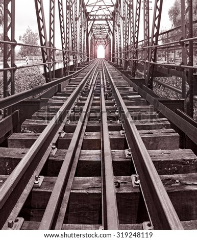 Railroad bridge in thailand ,Sepia color effect vintage style