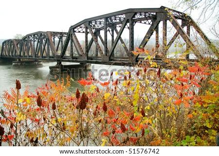 Railroad Bridge over a river - stock photo