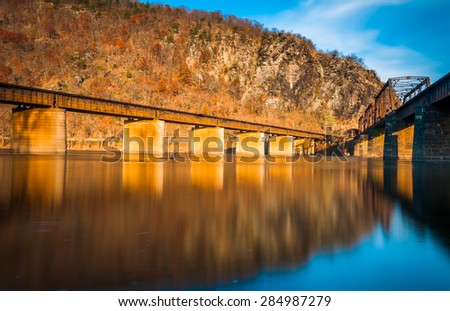 Railroad bridges over the Potomac River in Harper's Ferry, West Virginia. - stock photo