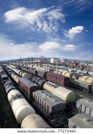 Railroad cars on a railway station. Cargo transportation. Work of industry. Urban scene. Wide angle. Panoramic view - stock photo