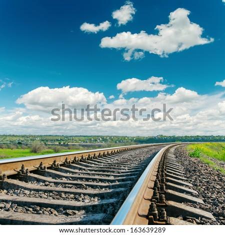 railroad closeup to cloudy horizon - stock photo