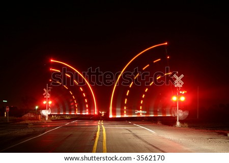 Railroad Crossing Arms at night - stock photo
