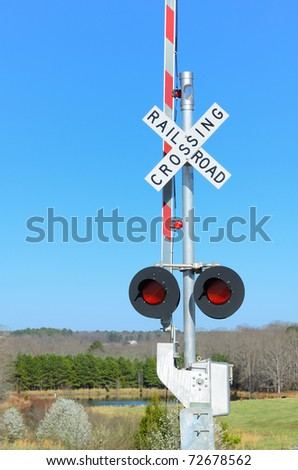 Railroad Crossing in a rural setting - stock photo