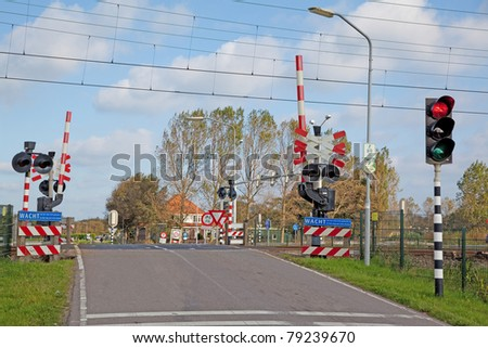 Railroad crossing in The Netherlands - stock photo