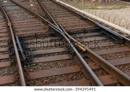 Railroad crossing, railway tracks at Arashiyama Station, Kyoto, Japan. - stock photo