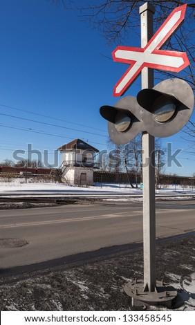 Railroad crossing. Red traffic sign with flashing lights - stock photo