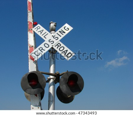 railroad crossing sign and gate - stock photo